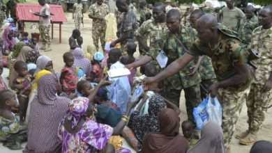 Military giving water to civilians in Borno State