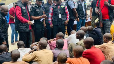 Security forces parading armed criminals operating across Nigeria.