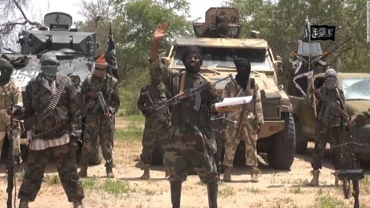 Leader of Boko Haram, Abubakar Shekau speaking in front of armoured vehicles