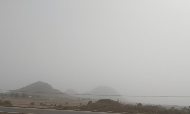 Dust haze covers the mountains along Abuja Airport Road.